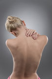 Woman massaging pain neck and back. Stock Photo