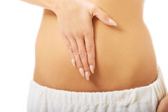 Woman massaging slim belly Stock Photography