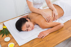 Woman massagist make body massage in spa wellness center Stock Photos