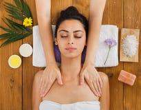 Woman massagist make body massage in spa wellness center. Massagist with women patient in aroma spa wellness center. Professional face and body massage to Stock Photo
