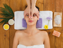 Woman massagist make face lifting massage in spa wellness center Royalty Free Stock Image