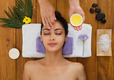 Woman massagist make face lifting massage in spa wellness center Royalty Free Stock Images