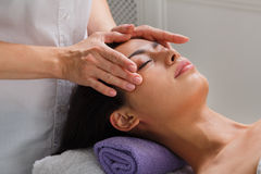 Woman massagist make face lifting massage in spa wellness center Stock Photos