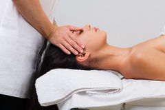 Woman massagist make face lifting massage in spa wellness center Stock Photo
