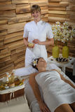 Woman and masseur at luxury spa room Royalty Free Stock Photography