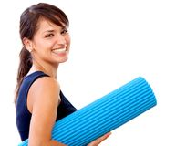 Woman with a mat Royalty Free Stock Photo