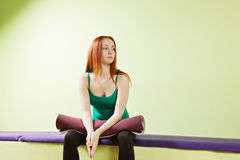 Woman with mat on knees Stock Photo