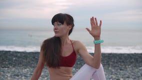 Woman in a Matsyasana Twist pose. stock video footage