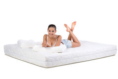 Woman and mattress Royalty Free Stock Image