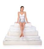 Woman and mattress Stock Image