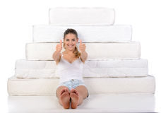 Woman and mattress Stock Photos