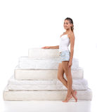Woman and mattress Royalty Free Stock Photography