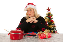 Woman of mature age alone with Christmas Stock Photo