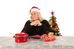Woman of mature age alone with Christmas Stock Photography