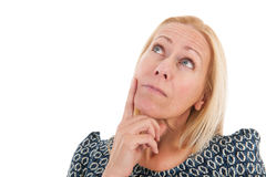 Woman of mature age looking up. Blond woman of mature age looking up isolated over white background Stock Photography
