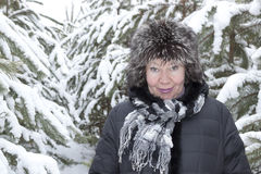 A woman of mature years in a fur hat Royalty Free Stock Image