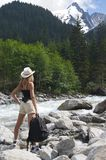 Woman in mauntains. Mountain river, model see on high peak Stock Photography