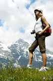Tourist Woman Hiking Mountains, Girl Backpacker Climbing, travel tourism Stock Photos