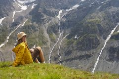 Woman in mauntains. Woman in mountains and see on high peak Stock Photo