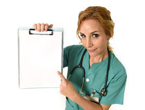 Woman md emergency doctor or nurse holding and showing blank copy space billboard folder royalty free stock image