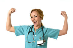 Woman md emergency doctor or nurse posing smiling cheerful with stethoscope showing biceps Royalty Free Stock Photography