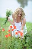 Woman in a meadow Royalty Free Stock Photos