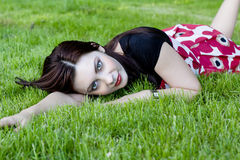 Woman on a meadow. Beautiful woman relaxing on a meadow Royalty Free Stock Photo