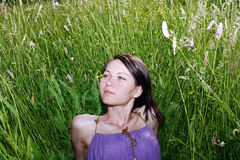 Woman in the meadow. Young woman in the meadow Royalty Free Stock Images