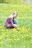Woman on meadow Stock Photography