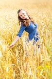 A woman in the meadow. A smiling woman in the meadow Stock Photography