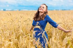 A woman in the meadow. A smiling woman in the meadow Royalty Free Stock Image