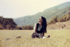 Woman on the meadow Stock Photos