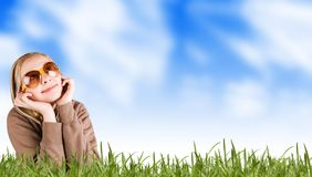 Woman on a meadow in grass stock image