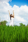 Woman  in a meadow Stock Images