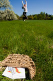 Woman meadow medicine. Young woman enjoying springtime on a meadow with calendar and pills for allergic people in foreground royalty free stock photos
