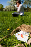 Woman meadow medicine sneeze. Young allergic woman sneeze into handkerchief on a meadow with calendar and pills for allergic people in foreground stock images