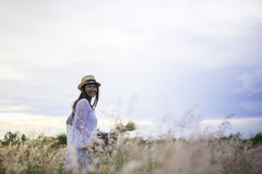 Woman in meadow. travel and sunset, Royalty Free Stock Photography