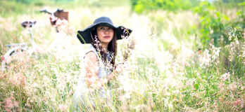 Woman in meadow. travel and sunset Stock Photos