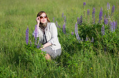 Woman in the meadow Royalty Free Stock Photos