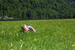 A woman on the meadow Royalty Free Stock Images