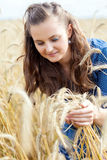 A woman in the meadow Stock Images