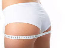 Woman measure ass Royalty Free Stock Image