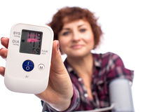 Woman measure blood pressure Royalty Free Stock Photos