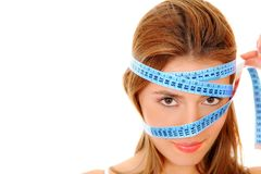 Woman with a measure tape Royalty Free Stock Photo