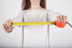 Woman with measure tape Stock Images