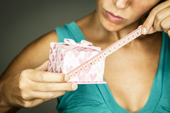 Woman measures a gift Stock Photo