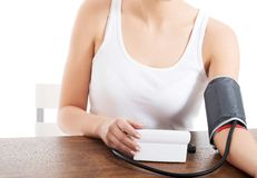 Woman measures her blood pressure Royalty Free Stock Photo