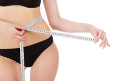 Woman measures her waist belly Stock Photos