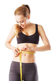Woman measures her waist fitness measure tape Royalty Free Stock Images