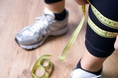 Woman measures a leg after running,fitness concept Stock Image